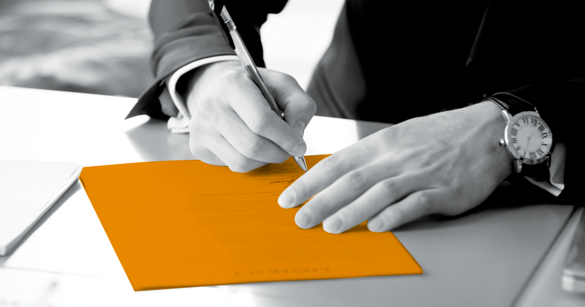 Image of a person signing a contract