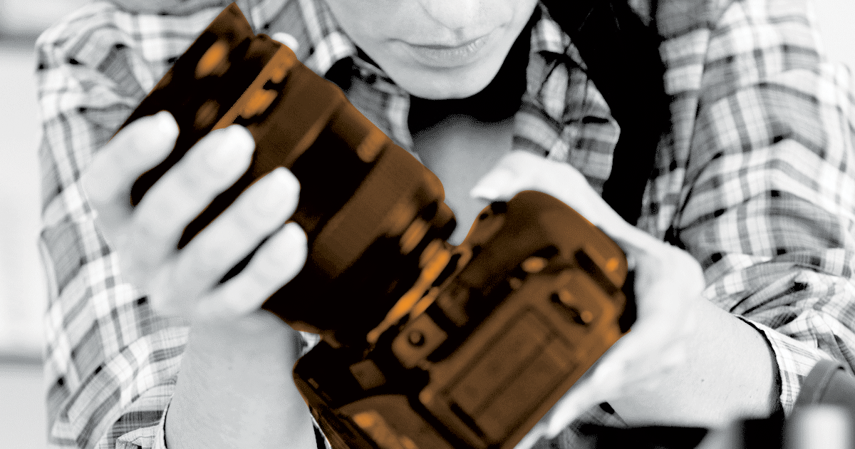 Image of a person holding and inspecting a camera.